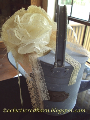 Eclectic Red Barn: Paper lace doilies, burlap and lace flowers on blue watering can