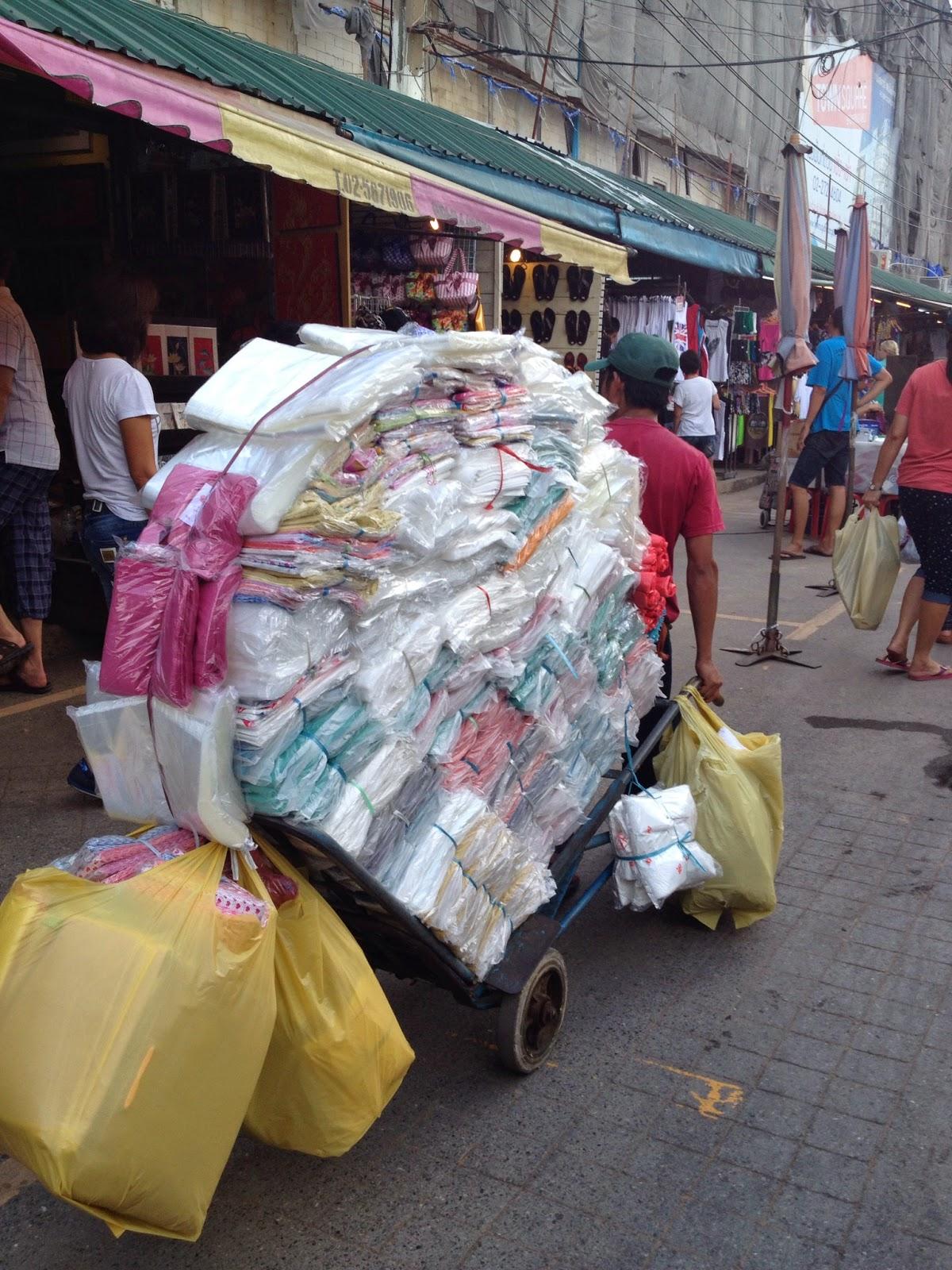 Bangkok - A vendor transporting his goods