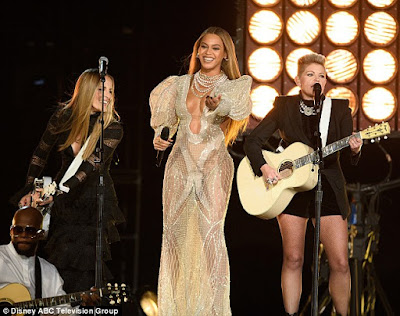 Beyonce steals the show in a low-cut sheer dress at the 50th Annual Country Music Association Awards