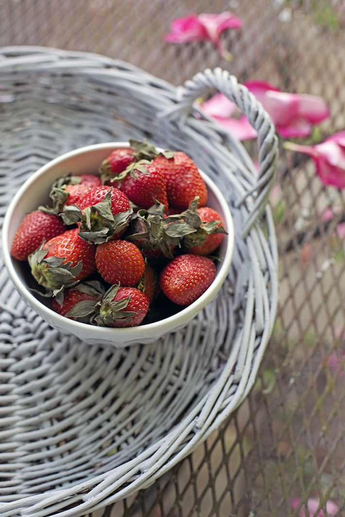 bowl of strawberries on a wicker tray
