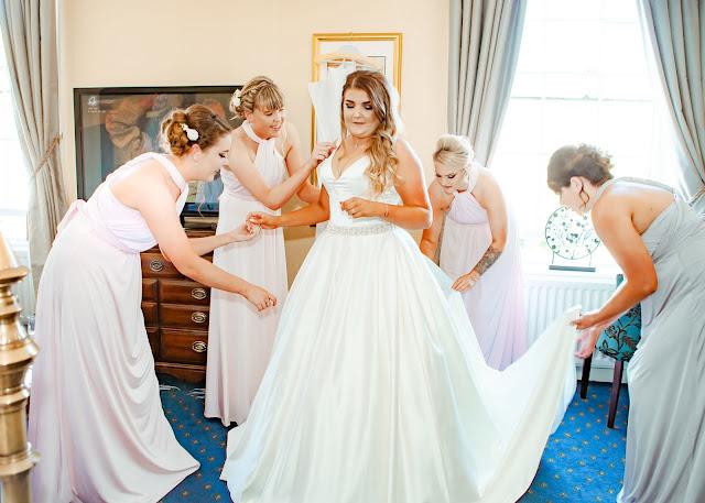 Wedding bride with bridesmaids getting ready