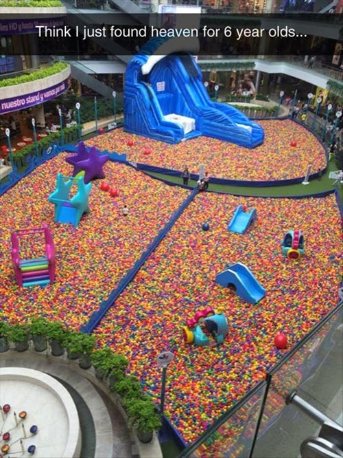 concourse of shopping mall turned over to ball pit kids adventure playground funny