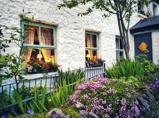 White Gables restaurant image from outside with flowers