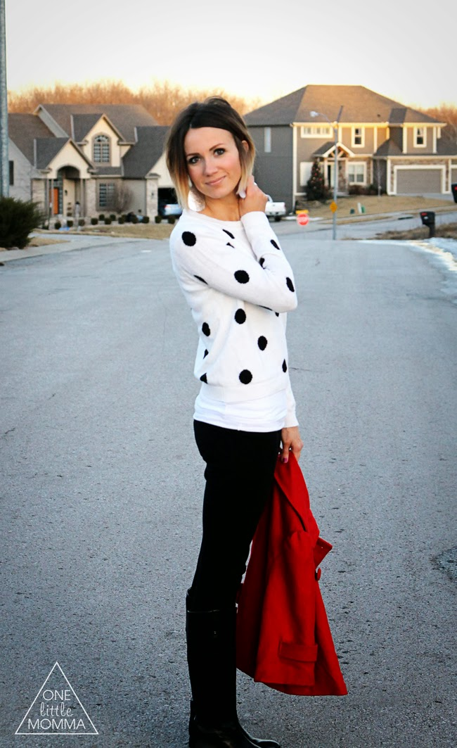 Black and white polka dot sweater, red coat