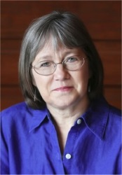 Photo of Robin Hobb, a white woman with shoulder-length dark grey hair.