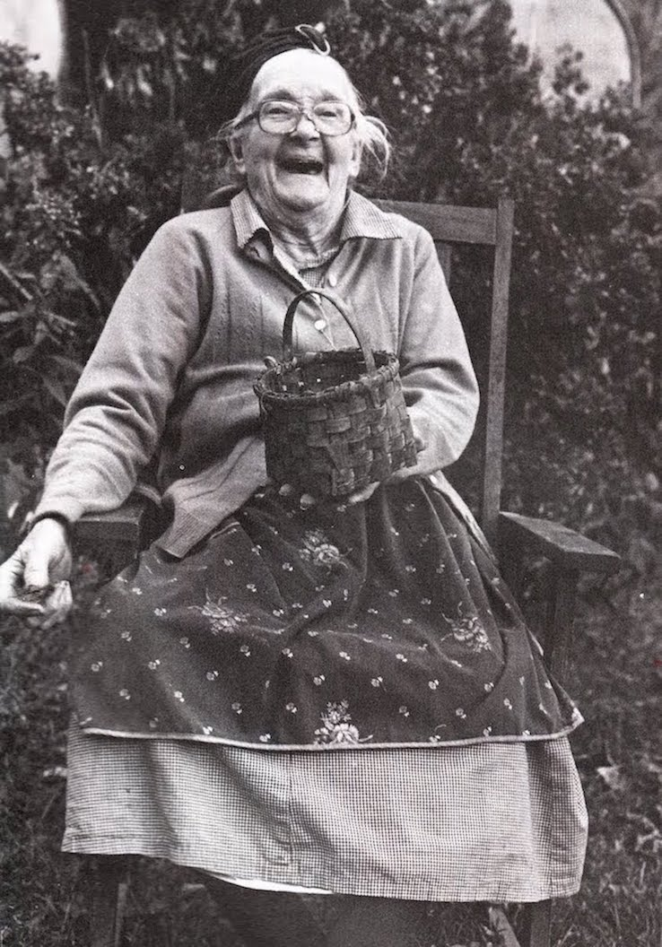 Gorgeous black and white photo of an old lady laughing in the garden Best April Fool. MarchMatron.com