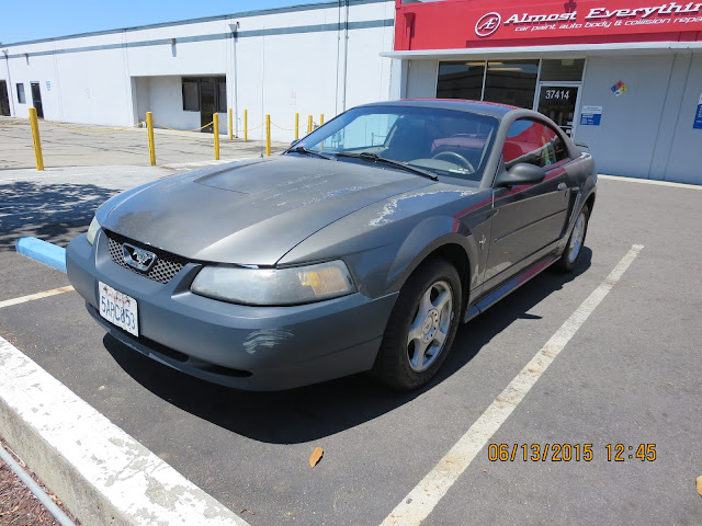 Mustang with dents & peeling paint before repairs at Almost Everything Auto Body