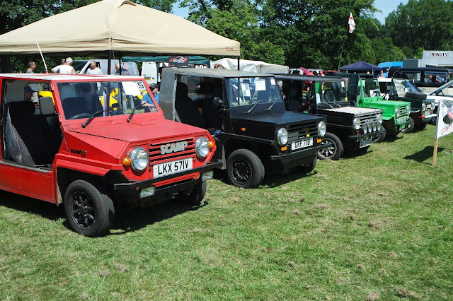 a row of red, black, and green doorless kit cars