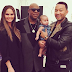 John Legend his wife Chrissy Teigen and daughter baby Luna pose with legendary Stevie Wonder