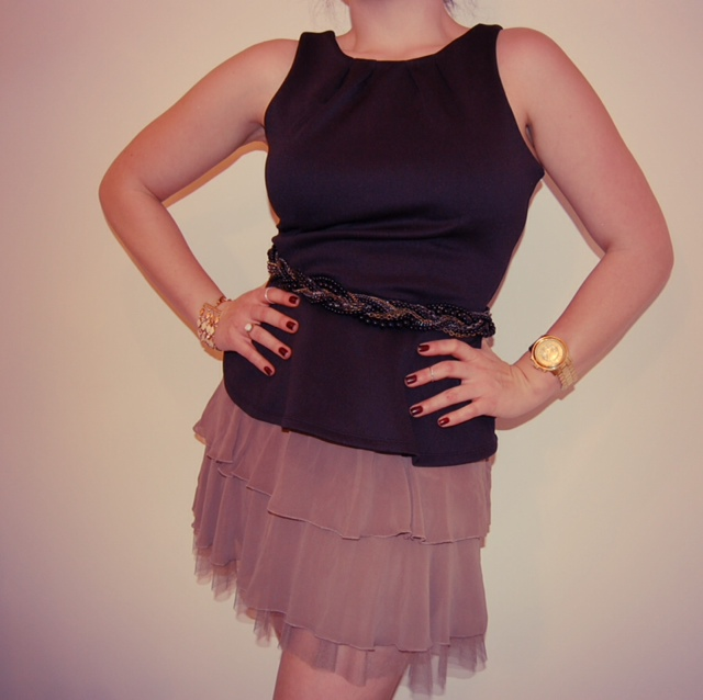 Neoprene peplum top with a metal and bead belt and a ruffle skirt