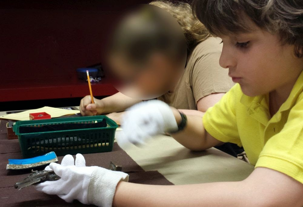 Week 18: In your (their) hands ~ William handling Egyptian artifacts at the ROM :: All Pretty Things