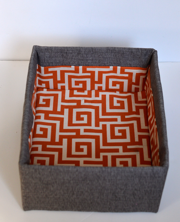 These turned out amazing! DIY fabric covered cardboard boxes.