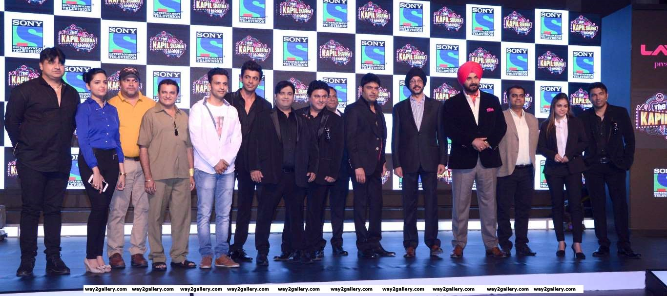 The cast and crew of The Kapil Sharma Show pose for photographers during the launch of the comedy show