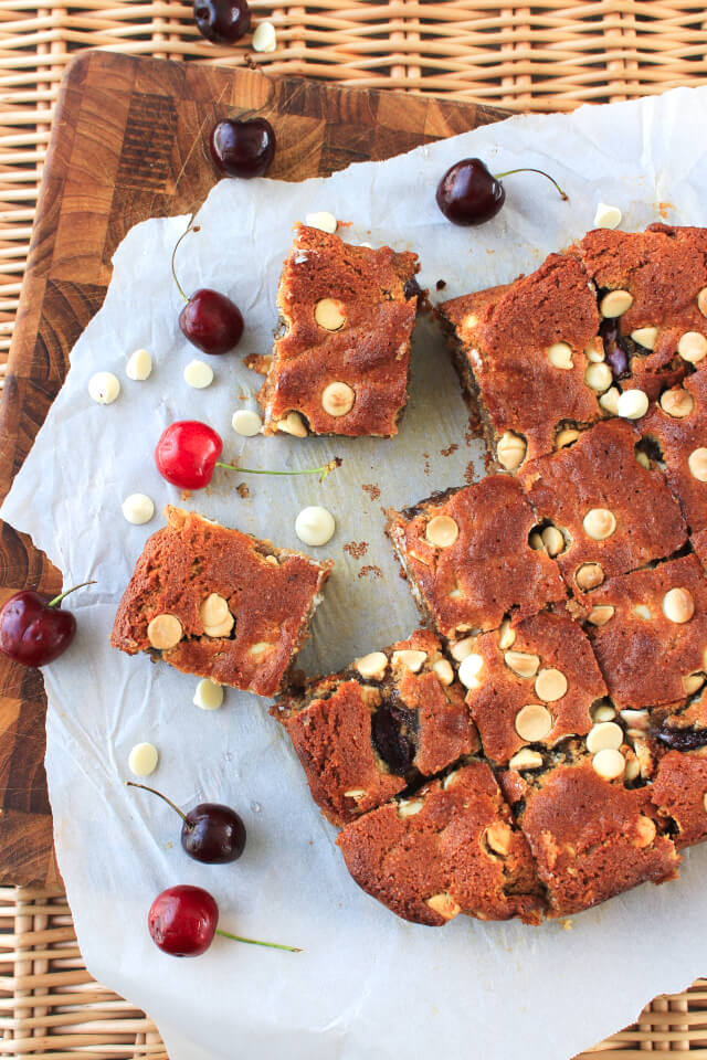 These White Chocolate Cherry Almond Butter Blondies are a better-for-you brownie made with coconut oil, almond flour, honey, and fresh cherries. #feastndevour