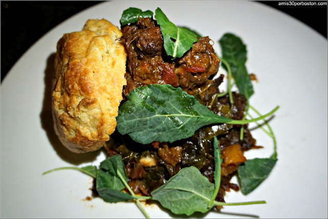 Slowly Braised Beef Cheek: Buttermilk biscuit, caramelized onion jam, collard greens