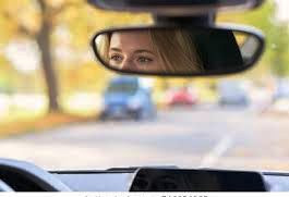 Taxi Driver looking at woman from the mirror