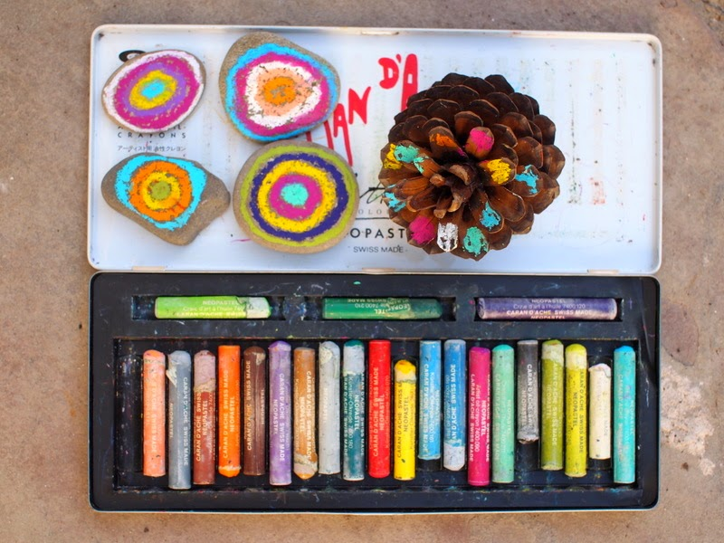 use oil pastels to decorate pumpkins for Halloween, rocks, and pine cones