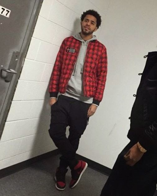 check out 236fa d602d J.Cole Wearing Air Jordan Bred 1 s
