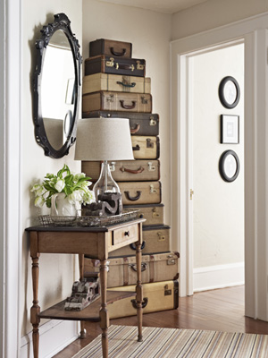 Add some style to your hallway with this stacked tower of vintage suitcases - creative decor!