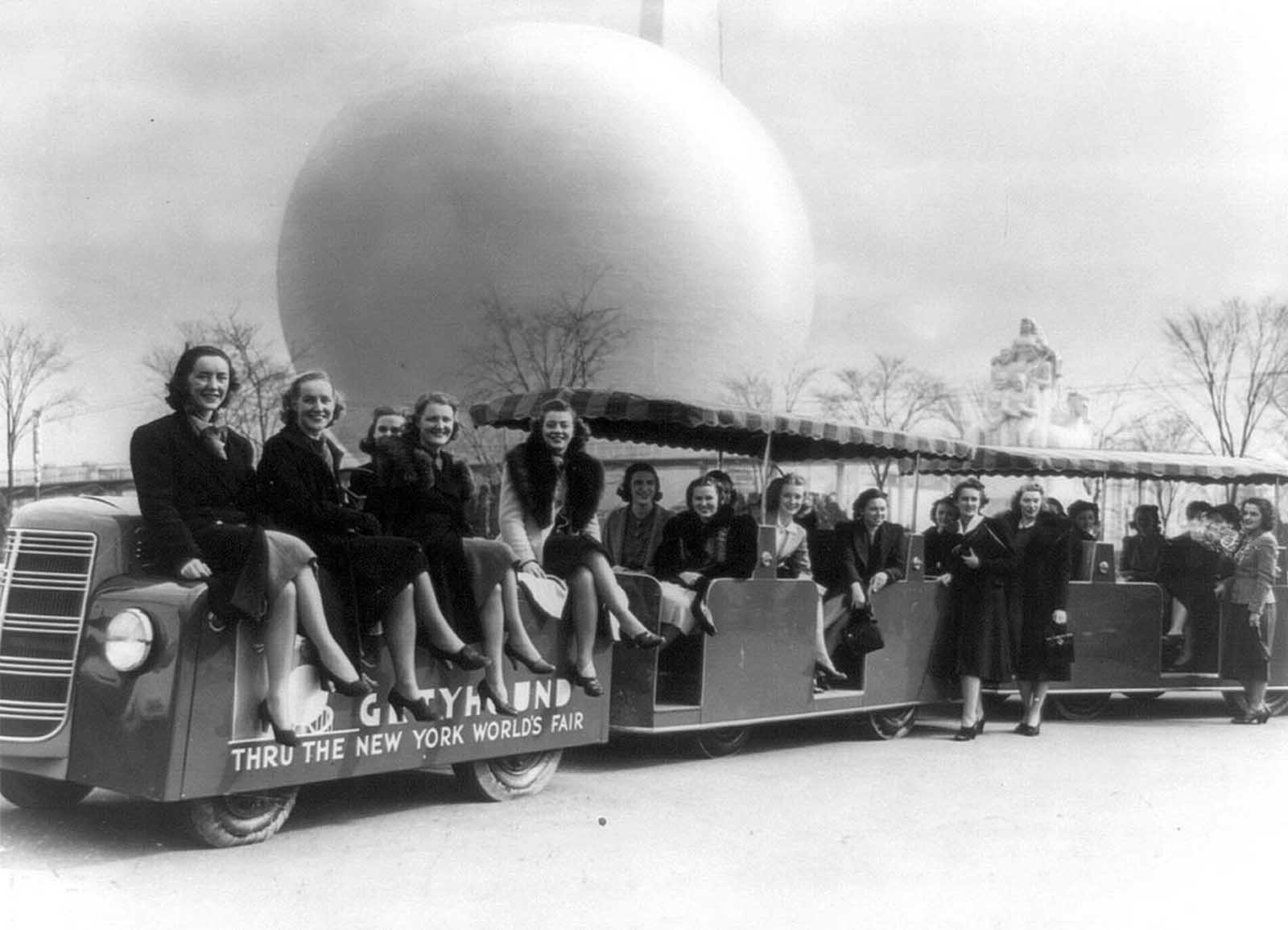 Members of the New York World's Fair staff, on a tractor train in 1939.