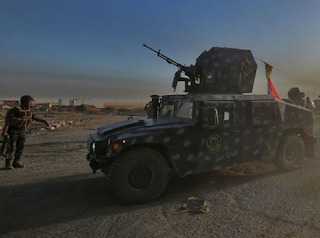 About two dozen people were killed in two suicide attacks in Iraq,