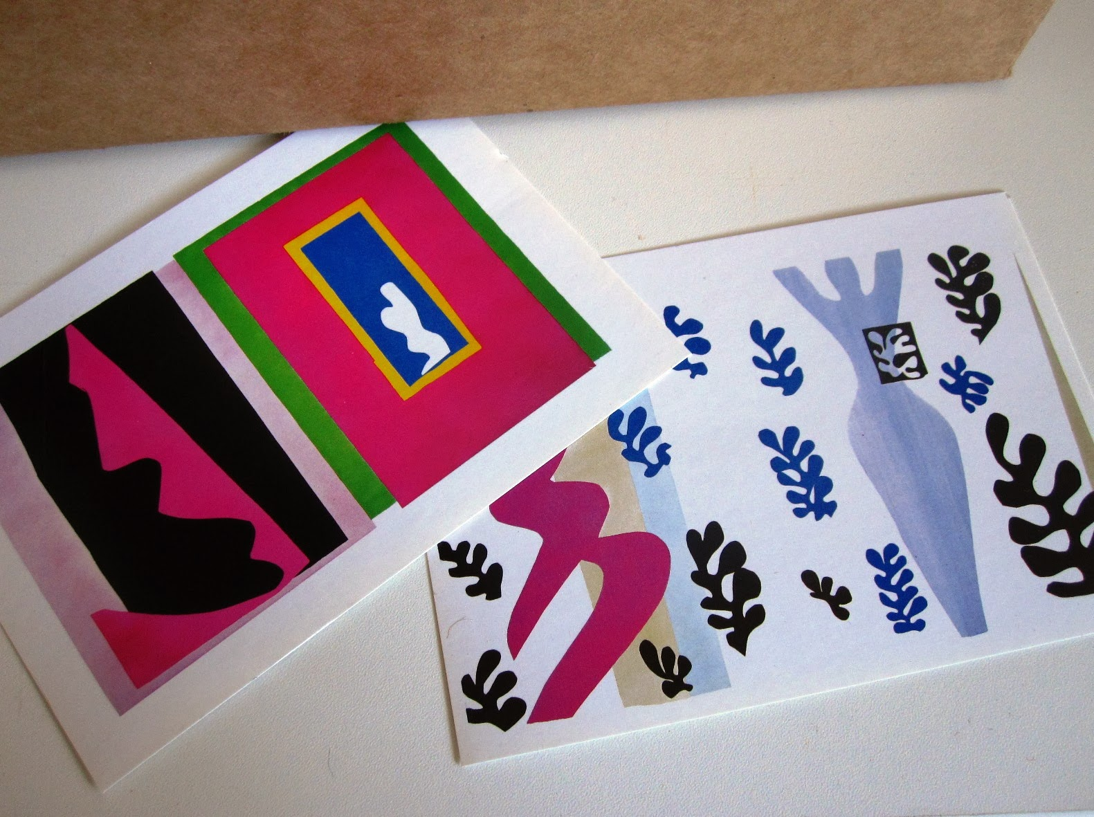 Two post cards with images by Matisse on them
