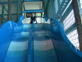 double bouncy slide in soft play facility