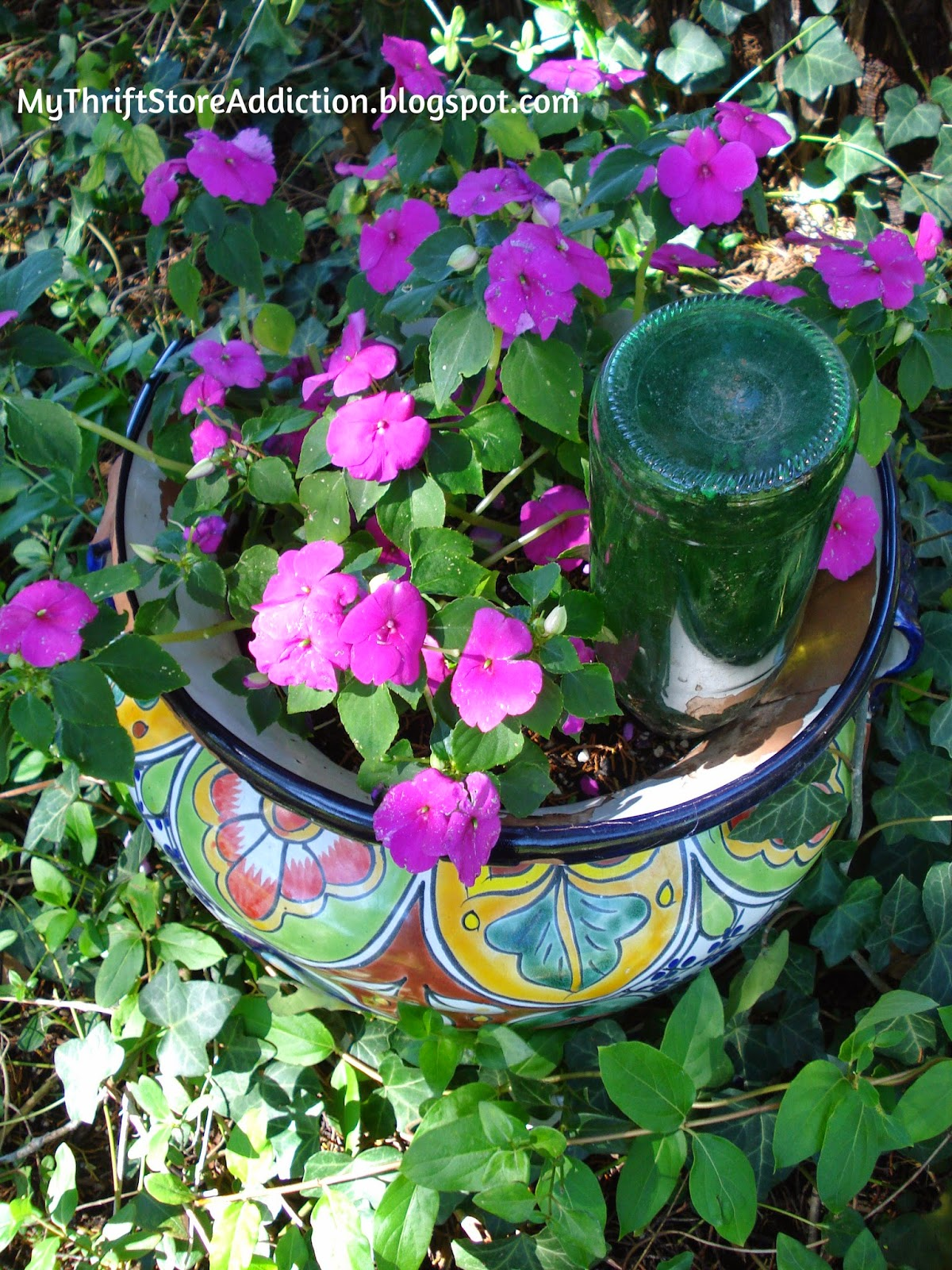 Repurposed wine bottle watering orb