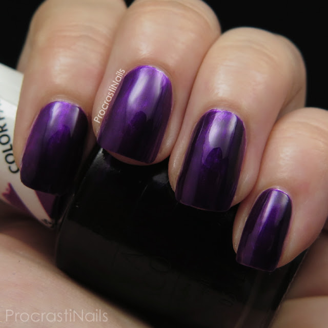 Swatch of OPI Purple Perspective which is a deep purple jelly polish