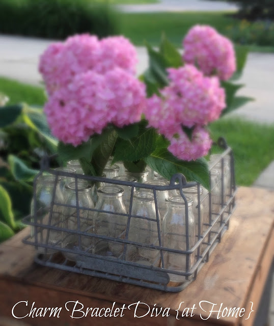 hydrangea vintage flower vase milk bottle wire carrying crate
