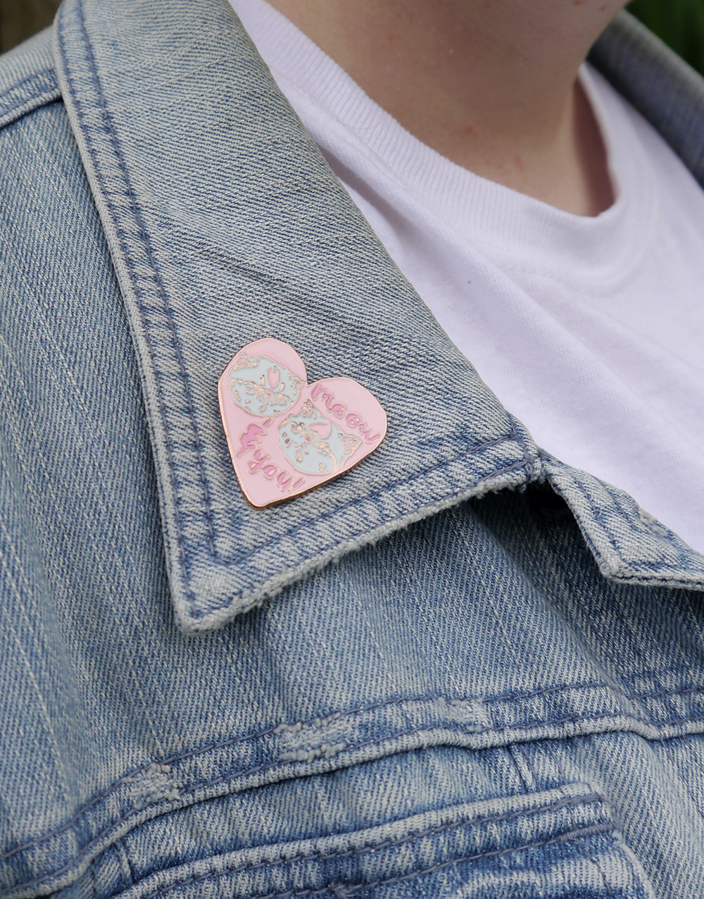 Meow & you pink cat enamal pin badge by Hello Harriet and Lucky Dip Club worn on a denim jacket
