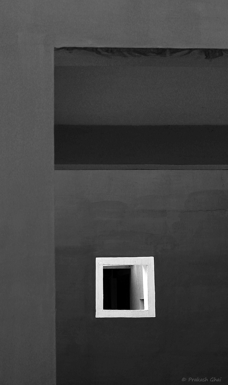A Minimalist Photo of a white square on a black wall at Jawahar Kala Kendra Jaipur.