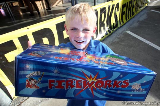 Lucan Blackburn, 5, with a box of fireworks his father Tony Blackburn, Hastings, bought from Bad Boy Fireworks, a pop-up shop in Pakowhai Rd, Hastings. photograph