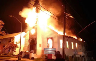 house surrounded with holy ghost fire