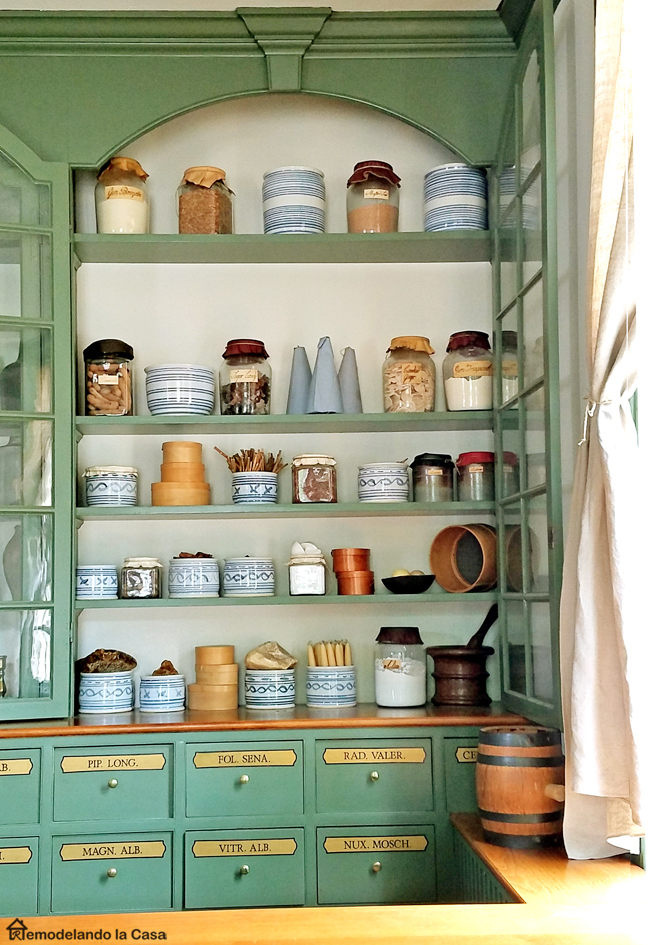 green built-ins in Colonial Williamsburg apothecary.