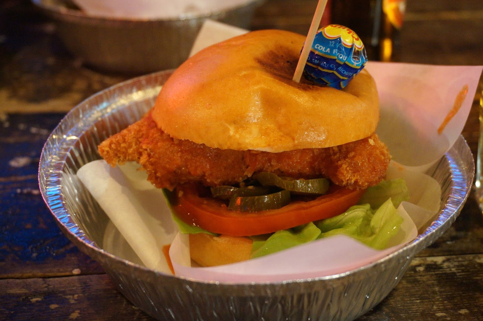 crunchy fried chicken breast burger smothered in hot buffalo sauce and pickles