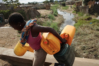 Carrying water home for the family in Nigeria Africa