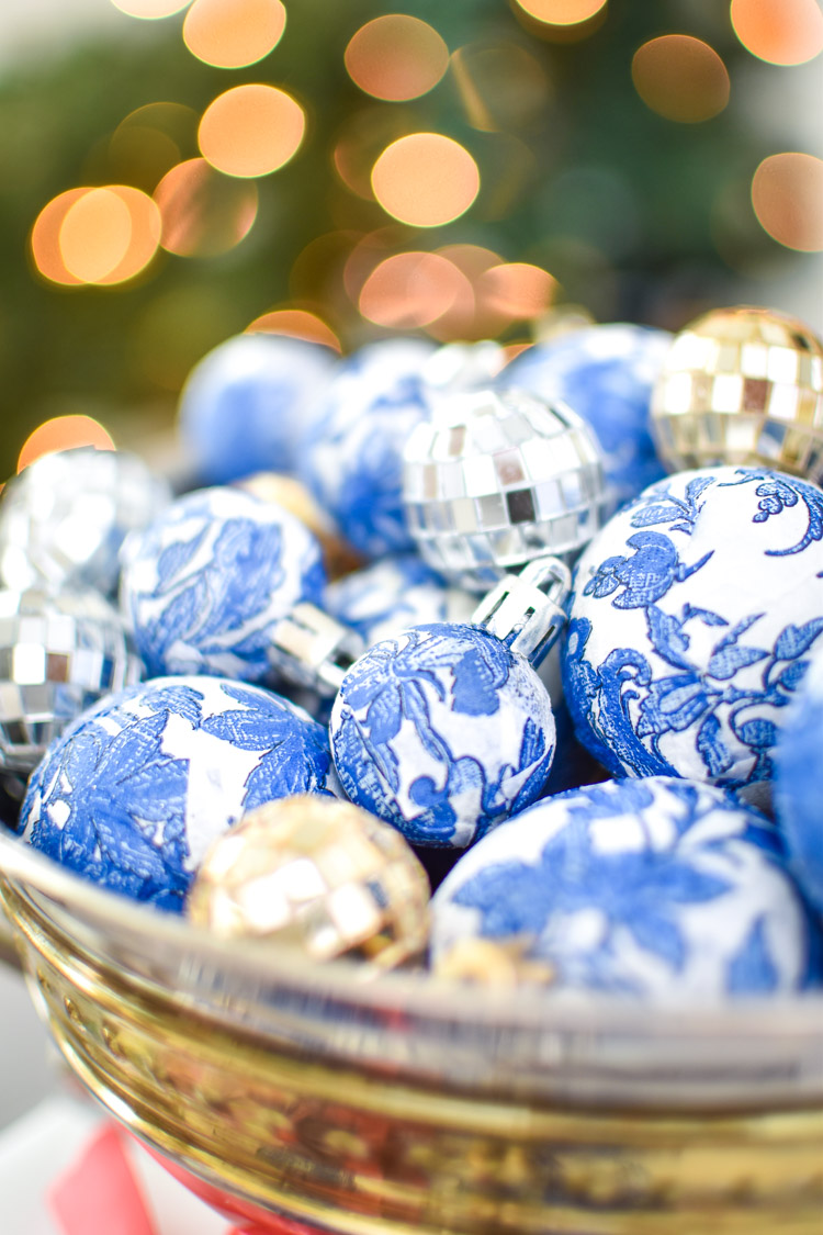 Blue and white chinoiserie Christmas ornaments in a bowl