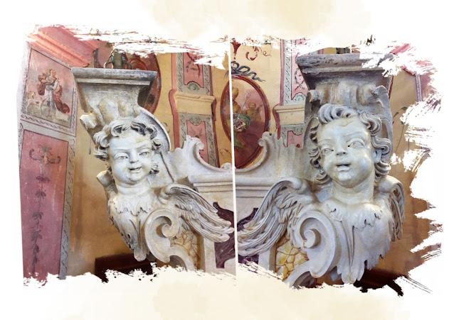 Teste di angioletti in pietra in stile barocco ai lati dell'altare