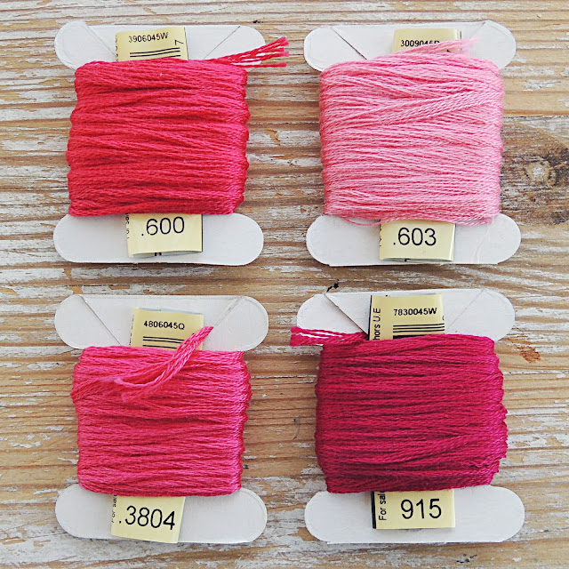 Four shades of pink embroidery floss by DMC