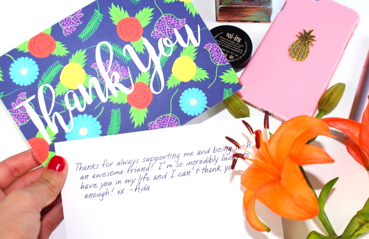 This is a close-up of a beautiful thank you card and handwritten note from me to my loyal readers.