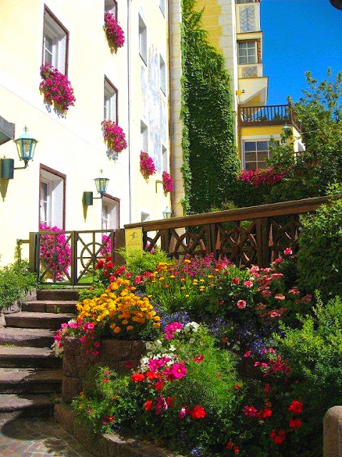 Blooms bursting with vibrant color on this enchanting street in Ortisei.