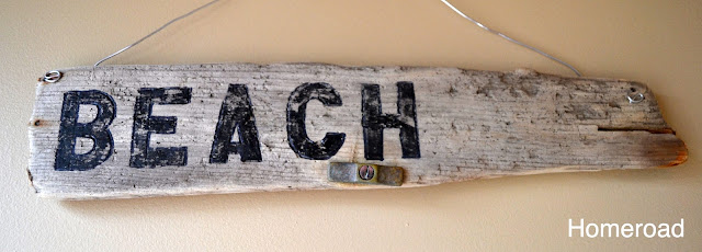 Driftwood with BEACH painted on it