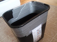 Trash can with duct tape on it