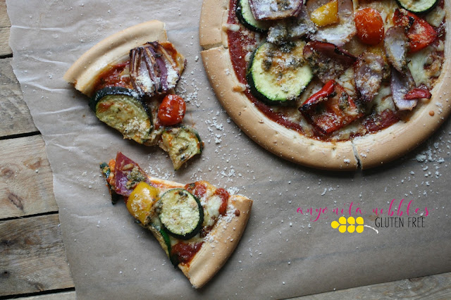 She roasts the veggies first and then adds them to the pizza crust before baking again. Recipe available on Anyonita Nibbles Gluten Free