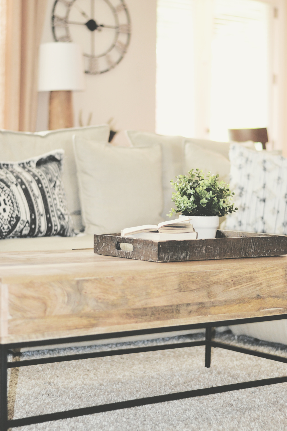 mango wood and metal coffee table and neutral couch