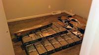 Laminate flooring installed. Before trim was reinstalled.