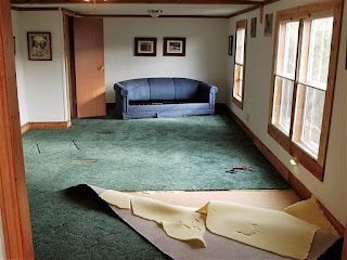 Removing carpet for wood flooring