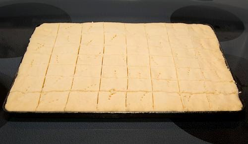 Baking tray of baked and cut shortbread bars.