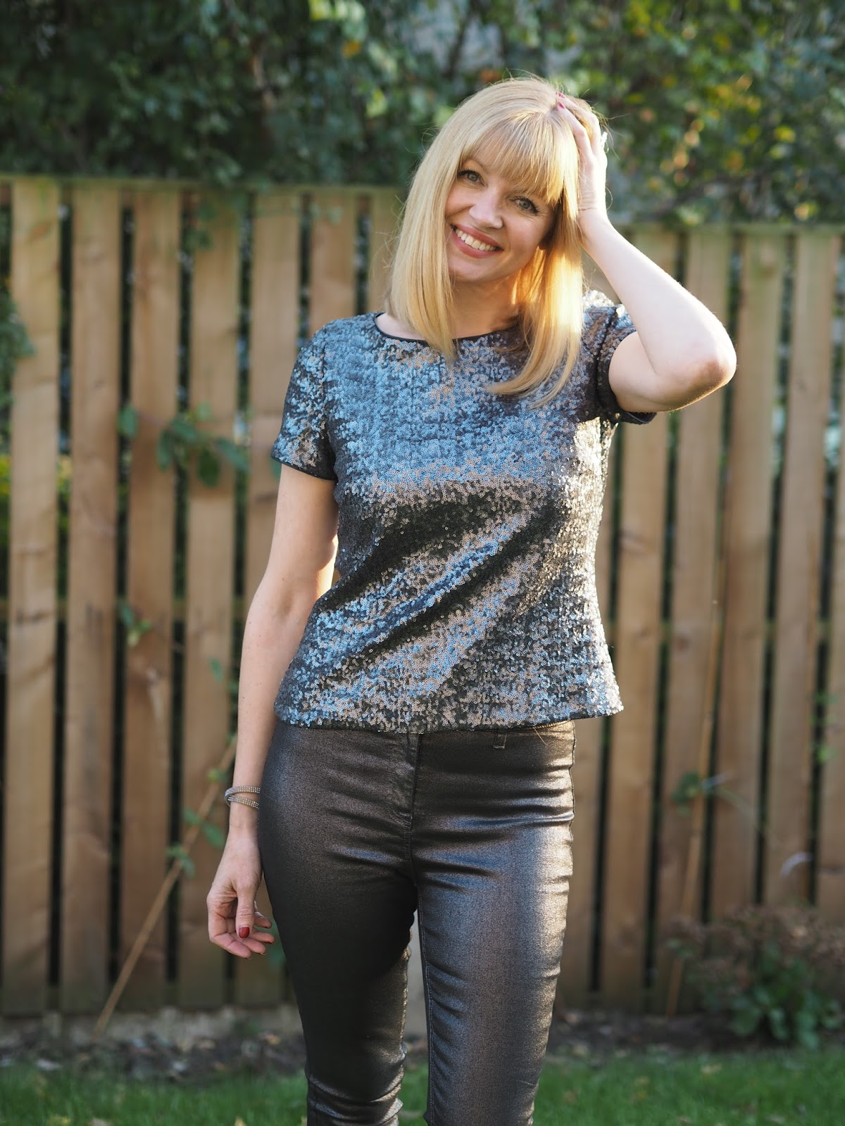 Gunmetal Sequin Top with Super Skinny Metallic Jeans and Snow Leopard Print Boots